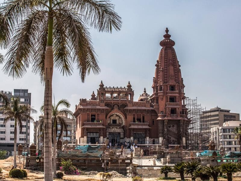 "This picture taken on August 18, 2019 shows restoration works ongoing at the historic ""Le Palais Hindou"" (also known as the ""Baron Empain Palace"") built by in the early 20th century by Belgian industrialist Edouard Louis Joseph, Baron Empain, in the classical Khmer architectural style of Cambodia's Angkor Wat, in the Egyptian capital Cairo's northeastern Heliopolis district.  Khaled DESOUKI / AFP"