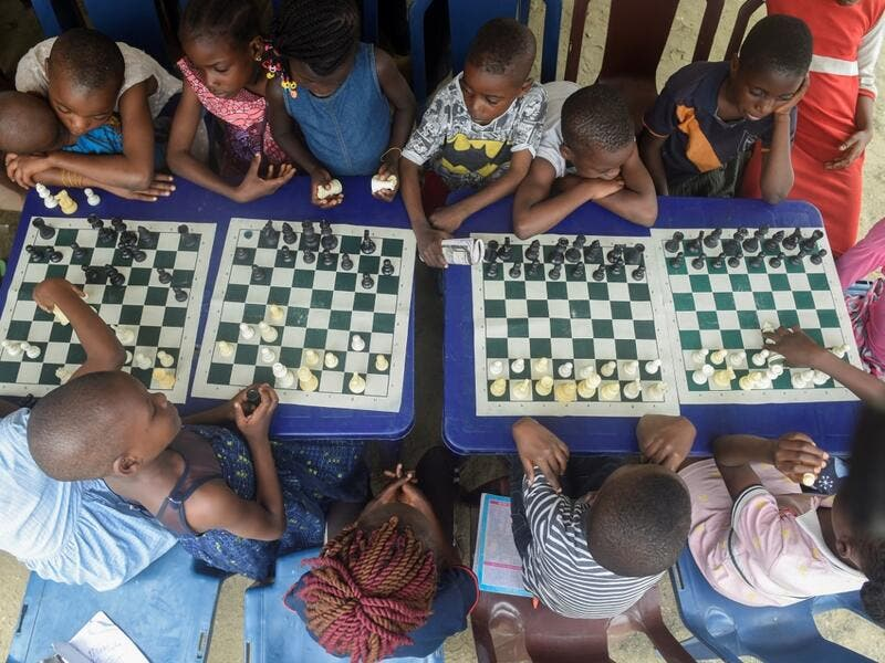They are thinking about the next move they will make, as part of a project that is supposed to bring hope to a slum in Nigeria's megapolis. While dozens of matches are played simultaneously, participants, some as young as three years old, practice this brain game often considered out of reach for the poor populations of Africa's most populous country. PIUS UTOMI EKPEI / AFP