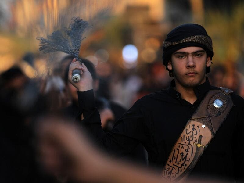 Iraqi Shiite men beat their backs with metal chains in the capital Baghdad's mostly Shiite neighbourhood of Kadhimiya marking the 8th day of Muharram, ahead of Ashura. Ahmad AL-RUBAYE / AFP