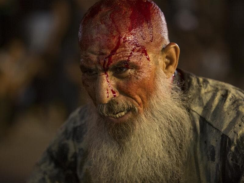 An Iraqi Shiite Muslim covered with blood takes part in commemorations marking the 8th day of Muharram ahead of Ashura , in the southern city of Basra. Hussein FALEH / AFP