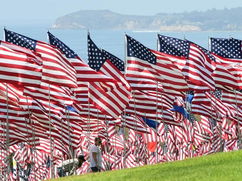 People visit the Pepperdine Wave of Flags display at Pepperdine University in Malibu, California, commemorating those who died in the September 11, 2001 attacks with 2,977 flags. Frederic J. BROWN / AFP