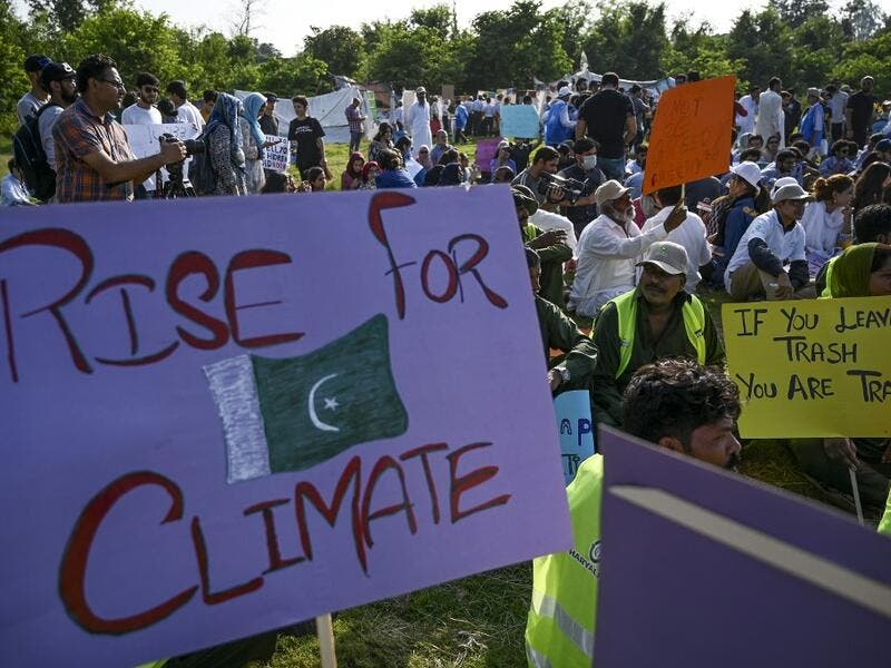"Youths hold placards as they sit during a climate strike to protest against governmental inaction towards climate breakdown and environmental pollution, part of demonstrations being held worldwide in a movement dubbed ""Fridays for Future"", in Islamabad on September 20, 2019. AAMIR QURESHI / AFP"