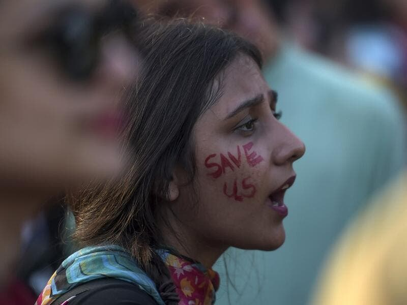"A youth shouts slogans as she sits during a climate strike to protest against governmental inaction towards climate breakdown and environmental pollution, part of demonstrations being held worldwide in a movement dubbed ""Fridays for Future"", in Islamabad on September 20, 2019. AAMIR QURESHI / AFP"