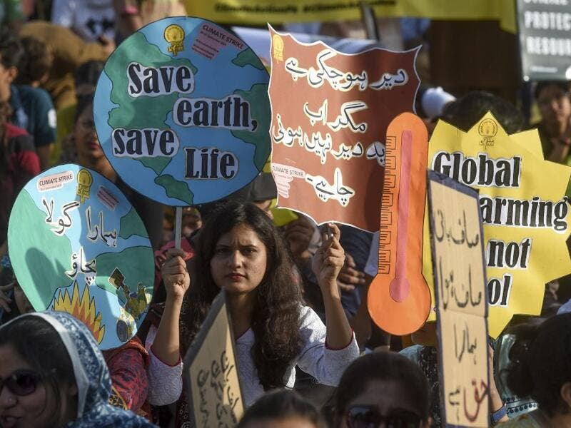 "Youths hold placards as they march for a climate strike to protest against governmental inaction towards climate breakdown and environmental pollution, part of demonstrations being held worldwide in a movement dubbed ""Fridays for Future"", in Karachi on September 20, 2019. ASIF HASSAN / AFP"