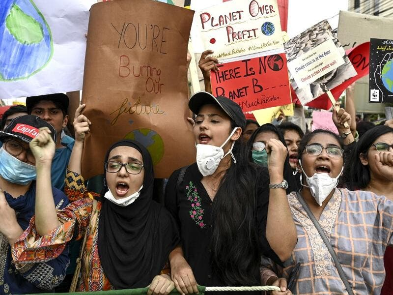 "Youths hold placards as they march for a climate strike to protest against governmental inaction towards climate breakdown and environmental pollution, part of demonstrations being held worldwide in a movement dubbed ""Fridays for Future"", in Lahore on September 20, 2019. ARIF ALI / AFP"