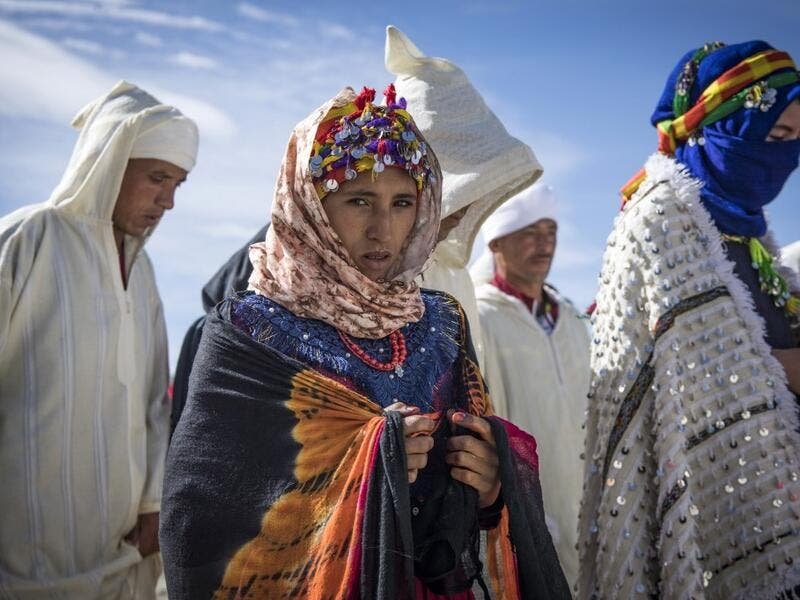 "Young Amazigh (Berber) men and women take part in the the annual ""Engagement Moussem"" festival near the village of Imilchil in central Morocco's high Atlas Mountains on September 21, 2019. Each year in the High Atlas Mountains hamlet of Ait Amer, tribes celebrate with dance and music, the collective wedding of young Amazigh couples during the traditional festival. FADEL SENNA / AFP"