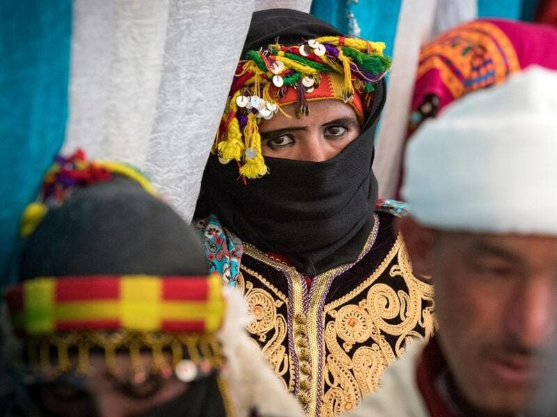 "Young Amazigh (Berber) men and women wait for their wedding ceremony during the annual ""Engagement Moussem"" festival near the village of Imilchil in central Morocco's high Atlas Mountains on September 21, 2019. Each year in the High Atlas Mountains hamlet of Ait Amer, tribes celebrate with dances and music, the collective wedding of young Amazigh couples during the traditional festival of ""Engagement Moussem"". FADEL SENNA / AFP"