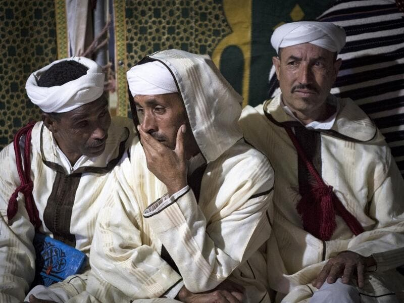 "Members of a traditional music group gather before performing at the annual ""Engagement Moussem"" festival near the village of Imilchil in central Morocco's high Atlas Mountains on September 21, 2019. Each year in the High Atlas Mountains hamlet of Ait Amer, tribes celebrate with dances and music, the collective wedding of young Amazigh couples during the traditional festival of ""Engagement Moussem"". FADEL SENNA / AFP"