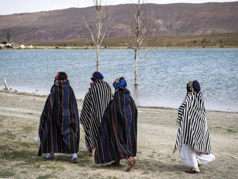 "Amazigh (Berber) women arrive to take part in the annual ""Engagement Moussem"" festival near the village of Imilchil in central Morocco's high Atlas Mountains on September 21, 2019. Each year in the High Atlas Mountains hamlet of Ait Amer, tribes celebrate with dances and music, the collective wedding of young Amazigh couples during the traditional festival of ""Engagement Moussem"". FADEL SENNA / AFP"
