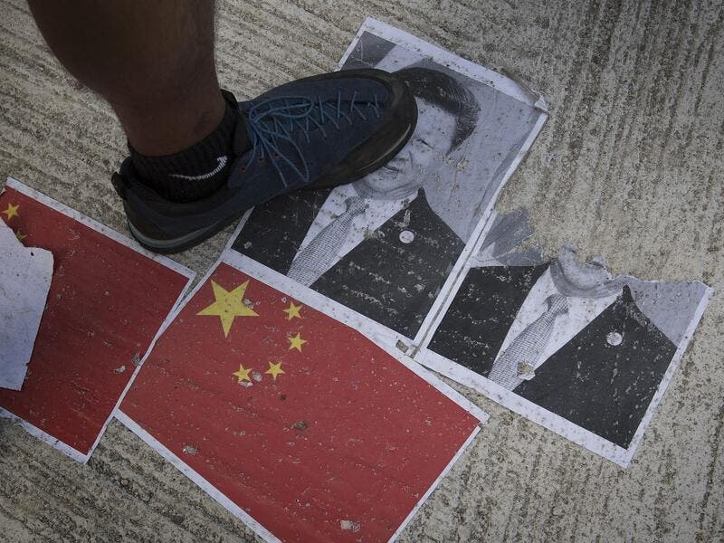 "Strife-torn Hong Kong on October 1 marked the 70th anniversary of communist China's founding with defiant ""Day of Grief"" protests and fresh clashes with police as pro-democracy activists ignored a ban and took to the streets across the city. Mark RALSTON / AFP"