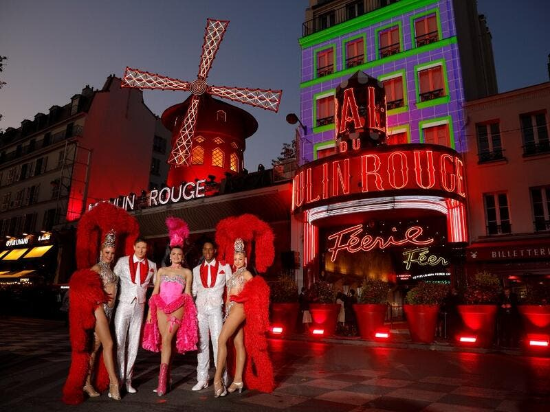Moulin Rouge cabaret's French dancer Mathilde (2ndL) and Australian dancer Rhylee (2ndR) pose during the celebration of the 130th anniversary of the French oldest cabaret, on October 6, 2019 in Paris.  GEOFFROY VAN DER HASSELT / AFP