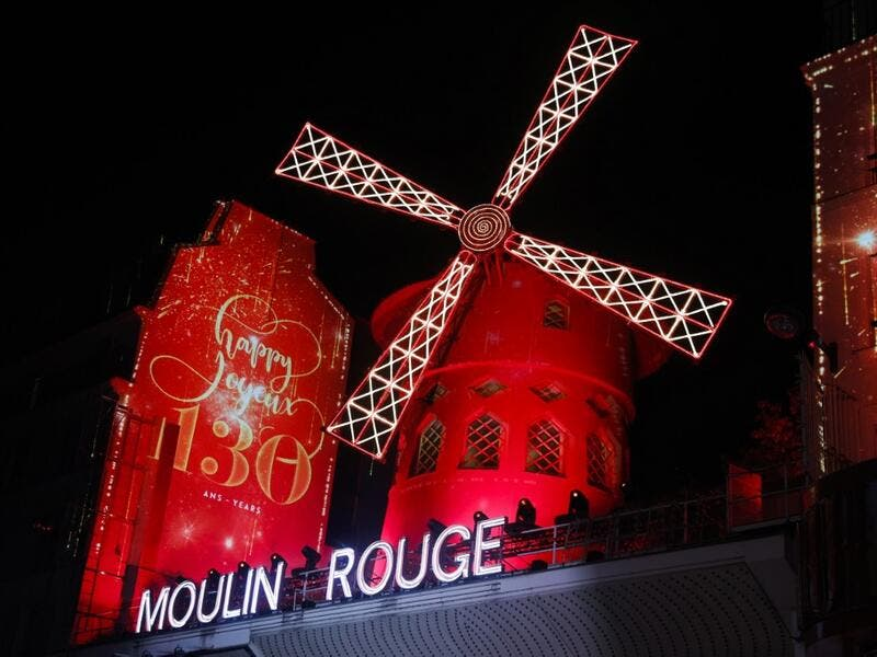 This picture taken on October 6, 2019 shows Moulin Rouge logo during the celebration of the 130th anniversary of the French oldest cabaret, in Paris.  GEOFFROY VAN DER HASSELT / AFP