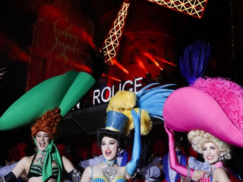 Moulin Rouge dancers pose during the celebration of the 130th anniversary of the French oldest cabaret, on October 6, 2019 in Paris.  GEOFFROY VAN DER HASSELT / AFP