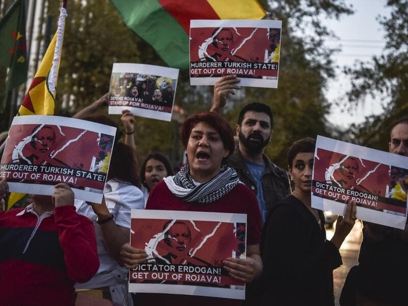 "Kurds living in Athens hold banners as they protest near the Turkish embassy in Athens, on October 9, 2019. Turkey launched an assault on Kurdish forces in northern Syria with air strikes and explosions reported along the border. President Recep Tayyip Erdogan announced the start of the attack on Twitter, labelling it ""Operation Peace Spring"". Louisa GOULIAMAKI / AFP"