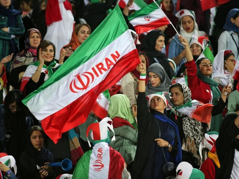 Iranian women cheer ahead of the World Cup Qatar 2022 Group C qualification football match between Iran and Cambodia at the Azadi stadium in the capital Tehran on October 10, 2019. (AFP/File)