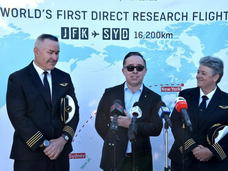 Qantas Group CEO, Alan Joyce (C) Qantas pilot, Captain Sean Golding (L) and Qantas Fleet Manager, Lisa Norman (R) speak to the media after completing a non-stop test flight from New York to Sydney at Sydney international airport on October 20, 2019. The Qantas Boeing 757 completed the flight, non-stop New York to Sydney in 19 hours and 15 minutes. (PETER PARKS / AFP)