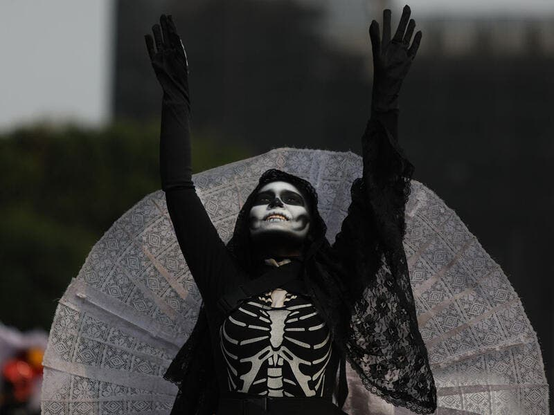A costumed participant walks in the annual International Day of the Dead Parade in Mexico City  Emilio Espejel / Anadolu Agency / Getty