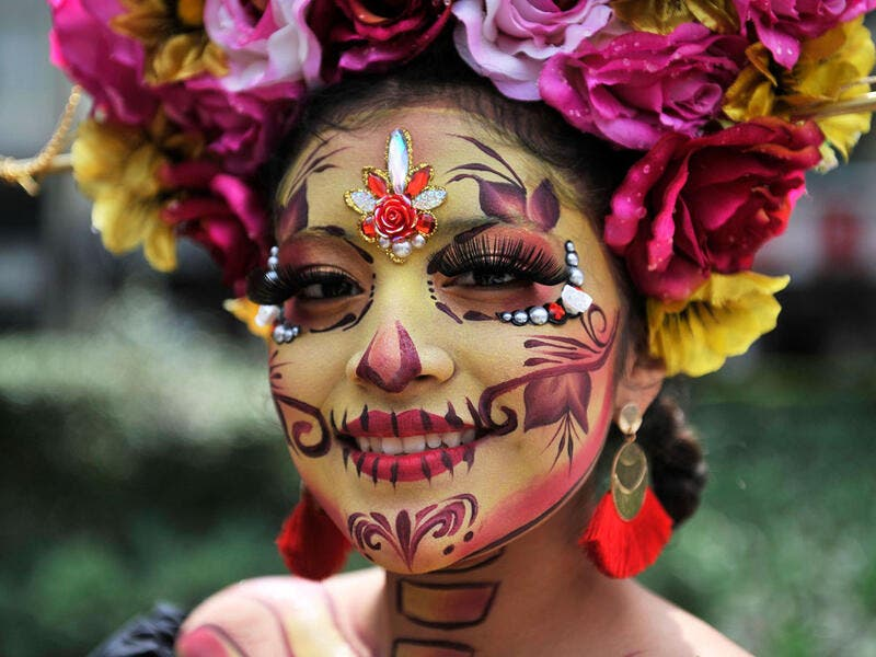 A woman dressed as Catrina takes part in the Catrinas Parade along Reforma Avenue in Mexico City Claudio Cruz / AFP / Getty