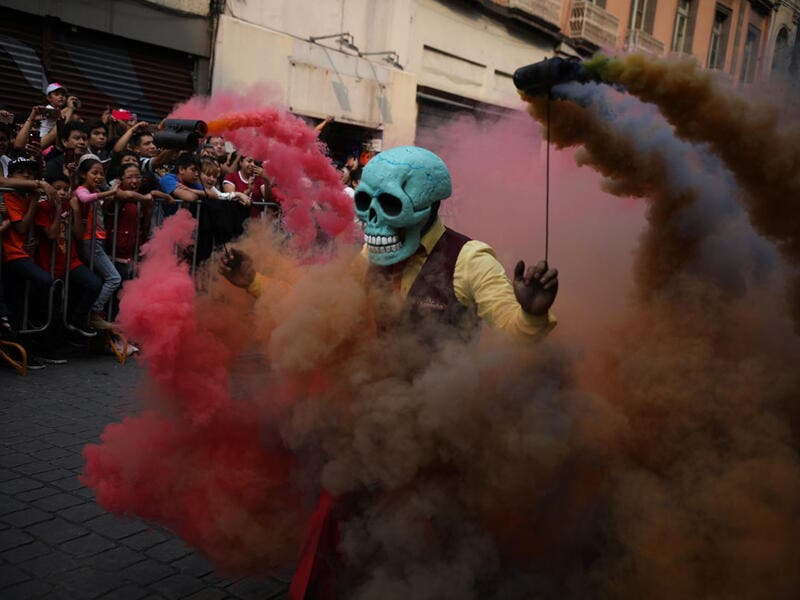 Participants in costume perform during the annual International Day of the Dead Parade in Mexico City  Emilio Espejel / Anadolu Agency / Getty
