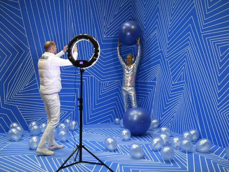 "Manfred Dederl (R) is being photographed at the ""Supercandy Pop-Up Museum Vol. 2"" in Cologne, western Germany on November 1, 2019. It is an interactive museum and offers the perfect photo backdrop for social media at 25 stations. INA FASSBENDER / AFP"
