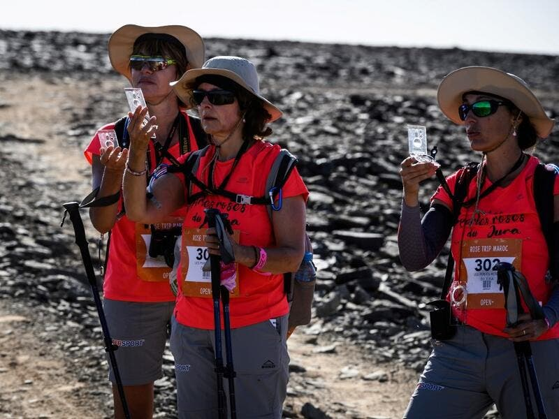 "Women take part in the desert trek ""Rose Trip Maroc"", on November 3, 2019 in the erg Chebbi near Merzouga. The Rose Trip Maroc is a female-oriented trek where teams of three must travel through the southern Moroccan Sahara desert with a compass, a map and a topographical reporter. JEAN-PHILIPPE KSIAZEK / AFP"