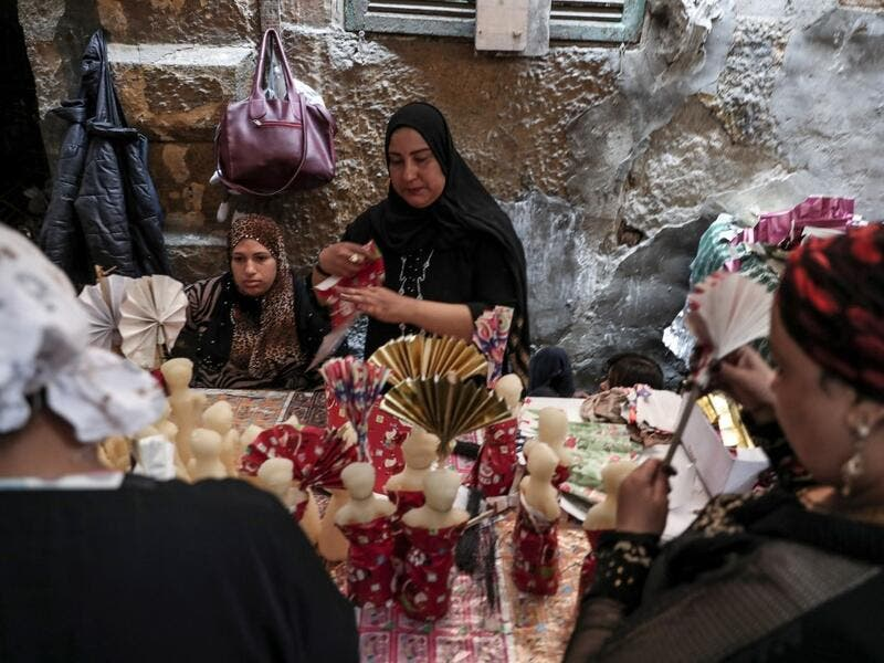 "Egyptian women decorate traditional sugar statuettes in the capital Cairo on November 2, 2019, ahead of celebrations of the Muslim Prophet Mohammed's birthday, known as ""Al Mawlid Al Nabawi"". Prophet Mohamed was born in Saudi Arabia's arid mountainous city of Mecca, the holiest in Islam, some 1490 years ago. Sunni Muslims in many parts of the world celebrate his birthday on the 12th day of the third month of the Islamic calendar, which will fall this year on November 9th.  Mohamed el-Shahed / AFP"