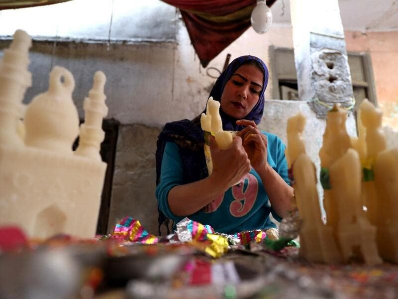 "An Egyptian woman decorates traditional sugar statuettes in the capital Cairo on November 2, 2019, ahead of celebrations of the Muslim Prophet Mohammed's birthday, known as ""Al Mawlid Al Nabawi"". Prophet Mohamed was born in Saudi Arabia's arid mountainous city of Mecca, the holiest in Islam, some 1490 years ago. Sunni Muslims in many parts of the world celebrate his birthday on the 12th day of the third month of the Islamic calendar, which will fall this year on November 9th.  Mohamed el-Shahed / AFP"