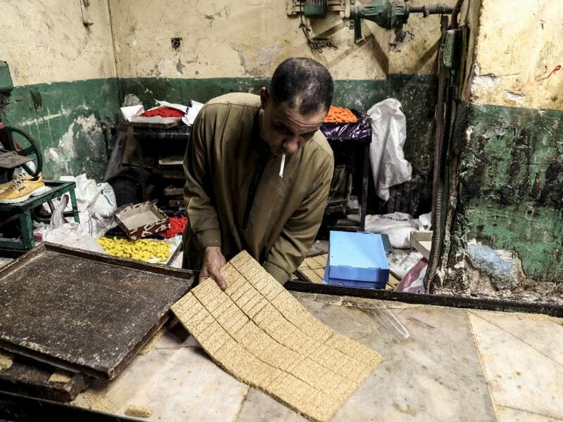 "An Egyptian confectioner shows bars of sweets with sesame at a candy factory in the capital Cairo on November 2, 2019, ahead of celebrations of the Muslim Prophet Mohammed's birthday, known as ""Al Mawlid Al Nabawi"". Prophet Mohamed was born in Saudi Arabia's arid mountainous city of Mecca, the holiest in Islam, some 1490 years ago. Sunni Muslims in many parts of the world celebrate his birthday on the 12th day of the third month of the Islamic calendar, which will fall this year on November 9th.  Mohamed el"