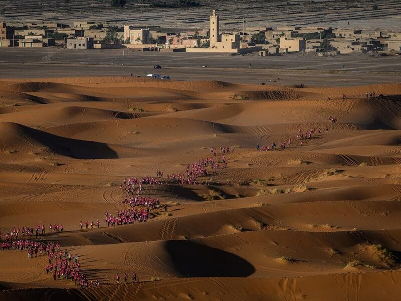 "Women take part in the desert trek ""Rose Trip Maroc"", on November 4, 2019 in the erg Chebbi near Merzouga. The Rose Trip Maroc is a female-oriented trek where teams of three must travel through the southern Moroccan Sahara desert with a compass, a map and a topographical reporter. JEAN-PHILIPPE KSIAZEK / AFP"