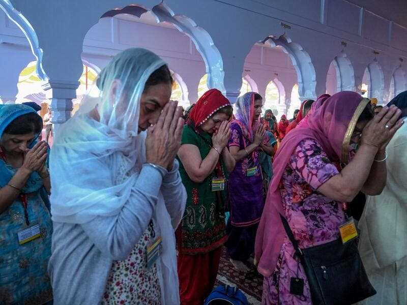 Sikh pilgrims pray at a shrine in Nankana Sahib, some 75 kms west of Lahore on November 7, 2019, on the occasion of the 550th birth anniversary of Guru Nanak Dev. A corridor that will allow Sikhs to cross from India into Pakistan to visit one of the religion's holiest sites is set to open on November 9, with thousands expected to make a pilgrimage interrupted by decades of conflict. Arif ALI / AFP
