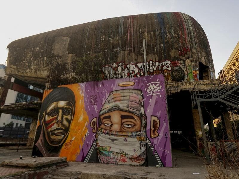"Graffitis are sprayed on a wall in front of ""the Egg"" building in Lebanon's capital Beirut on November 11, 2019. Since October 17, the chanting of tens of thousands of Lebanese denouncing the political elite have shaken the normally staid district around two Beirut squares, Martyrs' and Riad Al Solh. JOSEPH EID / AFP"