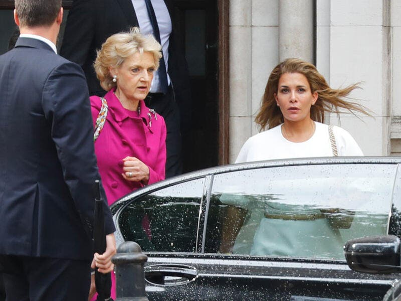 Princess Haya bint al-Hussein of Jordan (right), accompanied by her lawyer lawyer Fiona Shackleton (center), leaves the High Court in London on Tuesday. (Tolga Akmen/AFP/Getty Images)