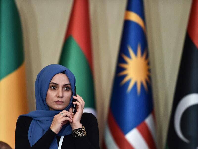 A woman speaks on the phone the opening ceremony of the 35th Ministerial Session of the Standing Committee for Economic and Commercial Cooperation of the Organization of Islamic Cooperation (COMCEC) on November 27, 2019 in Istanbul. Ozan KOSE / AFP
