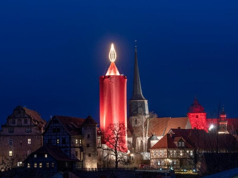 A picture taken on December 7, 2019 shows a tower made up as a giant candle in Schlitz, central Germany, as part of the Christmas celebrations. Boris Roessler / dpa / AFP