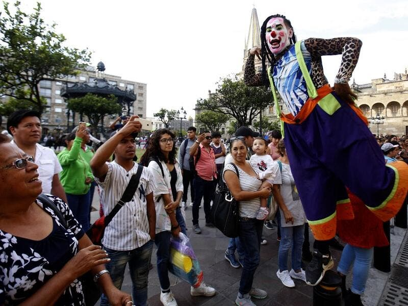 A group of clowns play during the International Clown Day in Guadalajara, Mexico, on December 10, 2019. Ulises Ruiz / AFP