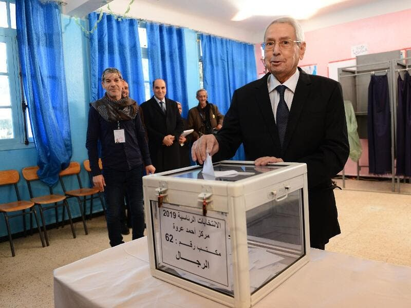 Algeria's interim president Abdelkader Bensalah casts his vote during the presidential election on December 12, 2019 at a polling station in Algiers. Five candidates are running in Algeria's presidential election to replace ousted Algerian president Abdelaziz Bouteflika. AFP