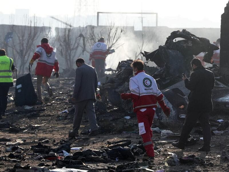 Rescue teams work amidst debris after a Ukrainian plane carrying 176 passengers crashed near Imam Khomeini airport in the Iranian capital Tehran early in the morning on January 8, 2020, killing everyone on board. The Boeing 737 had left Tehran's international airport bound for Kiev, semi-official news agency ISNA said, adding that 10 ambulances were sent to the crash site. AFP