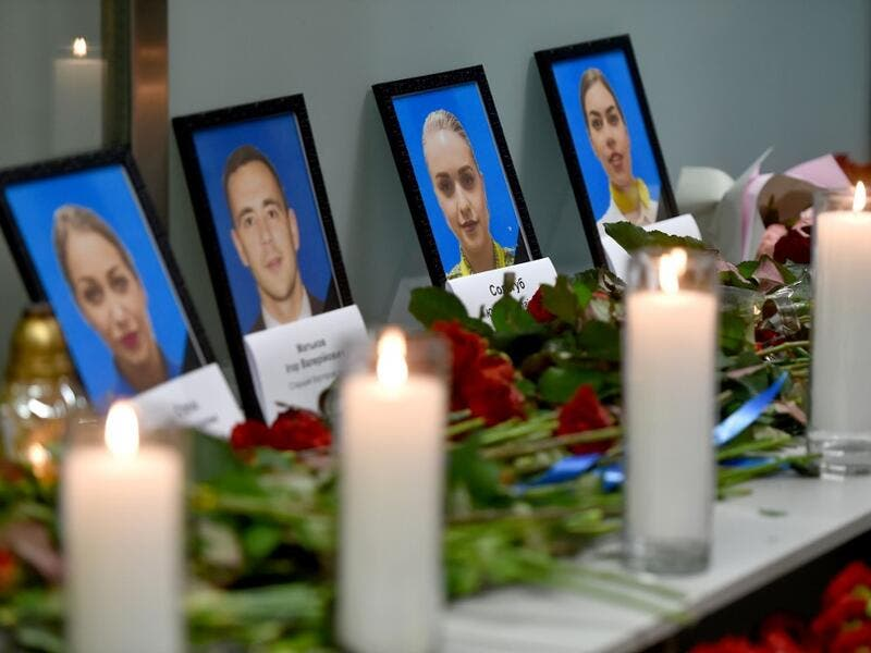 Portraits of the victims of the Ukraine International Airlines Boeing 737-800 crash in the Iranian capital Tehran, are seen at a memorial at the Boryspil airport outside Kiev on January 8, 2020. A Ukrainian airliner crashed shortly after take-off from Tehran Wednesday killing all 176 people on board, in a disaster striking a region rattled by heightened military tensions. Sergei SUPINSKY / AFP