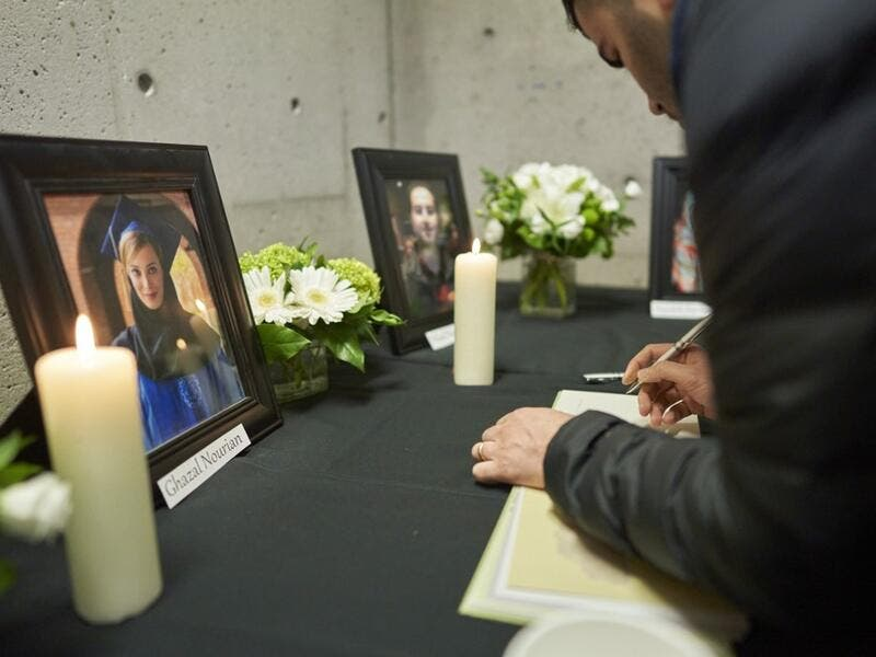 Mourners sign books of condolence at a memorial service at Western University in London, Ontario on January 8, 2020, for 4 of the school's graduate students who were killed in the plane crash in Iran, including Ghazal Nourian. A Ukrainian airliner crashed shortly after take-off from Tehran on January 8 killing all 176 people on board, in a disaster striking a region rattled by heightened military tensions. Geoff Robins / AFP