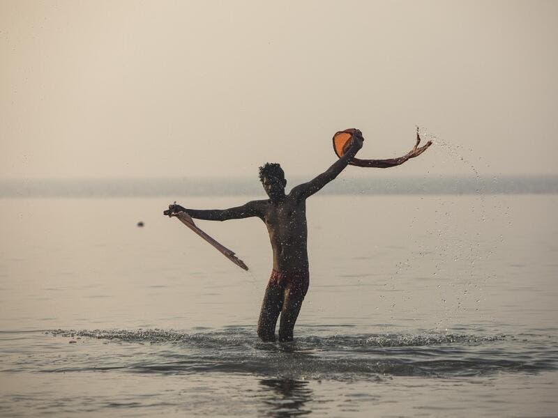 A Hindu devotee takes a holy dip in the Bay of Bengal during the Gangasagar Mela, at Sagar Island, some 150 kilometres south of Kolkata on January 14, 2020. Xavier GALIANA / AFP