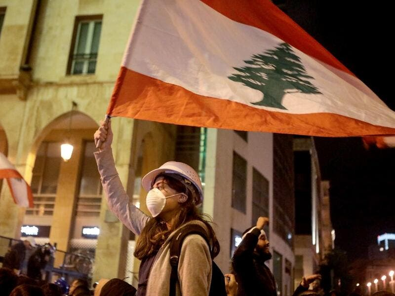 Lebanese protestors wave flags and shout anti-corruption slogans outside the parliament during a protest in downtown Beirut on January 21, 2020. (AFP/ File Photo)