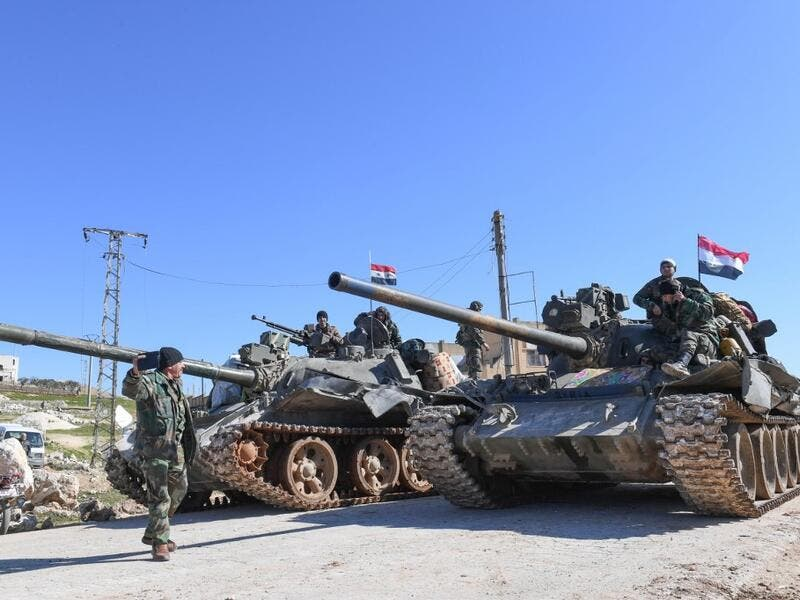 Syrian army units advance in the town of al-Eis in south Aleppo province on February 9, 2020, following battles with rebels and jihadists. Al-Eis, which overlooks the M5, was on a front that saw fierce fighting between the regime and its opponents in 2016. Syrian troops advancing north of Idlib linked up near Al-Eis with their comrades pushing south of Aleppo, state news agency SANA said. The two units had recently waged separate battles in rural Aleppo and southern Idlib, but are now conjoined for the firs