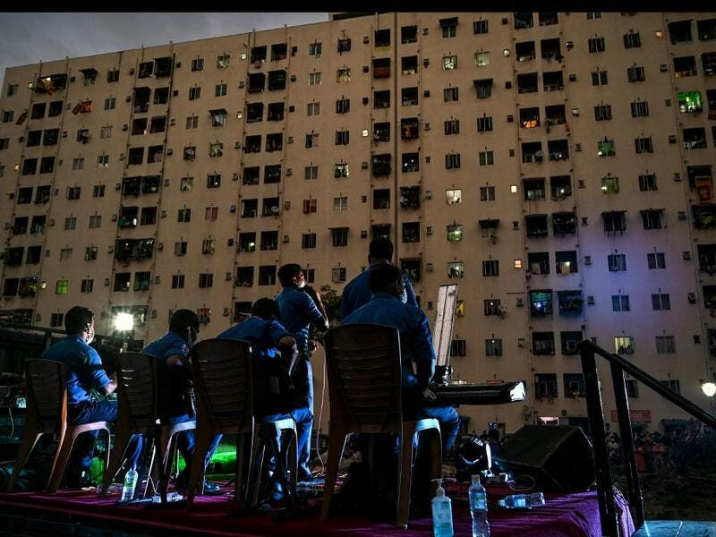 A music band formed by Sri Lankan Navy personnel plays outside a housing complex during a government-imposed nationwide lockdown as a preventive measure against the COVID-19 coronavirus, in Colombo on April 9, 2020. ISHARA S. KODIKARA / AFP