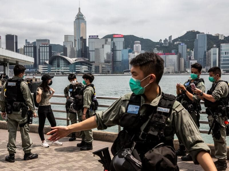 Police officers patrol the Tsim Sha Tsui waterfront where protests by pro-democracy demonstrators calling for the citys independence were scheduled to take place in Hong Kong on May 10, 2020. ISAAC LAWRENCE / AFP