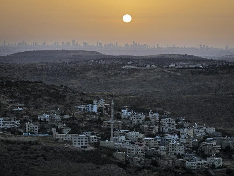 A picture taken from the Israeli settlement of Naale in the occupied West Bank northwest of the Palestinian city of Ramallah shows the skyline of the Israeli coastal city of Tel Aviv on June 17, 2020. The government of Israeli Prime Minister Benjamin Netanyahu has said it could begin the process to annex Jewish settlements in the West Bank as well as the strategic Jordan Valley from July 1. The plan -- endorsed by Washington -- would see the creation of a Palestinian state, but on reduced territory, and wit