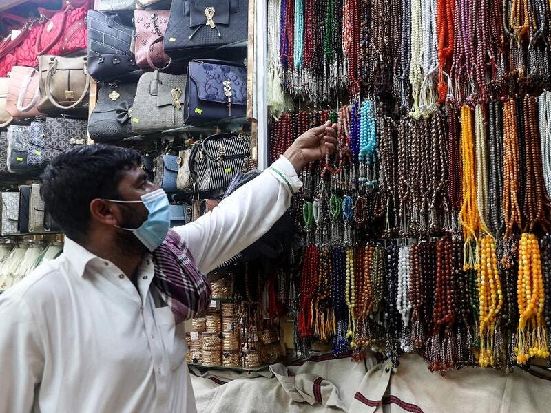 A man checks prayers beads in the holy city of Mecca on June 27, 2020. This year's hajj, which has been scaled back dramatically to include only around 1,000 Muslim pilgrims as Saudi Arabia battles a coronavirus surge, will begin on July 29, authorities said. Some 2.5 million people from all over the world usually participate in the ritual that takes place over several days, centered on the holy city of Mecca.  AFP