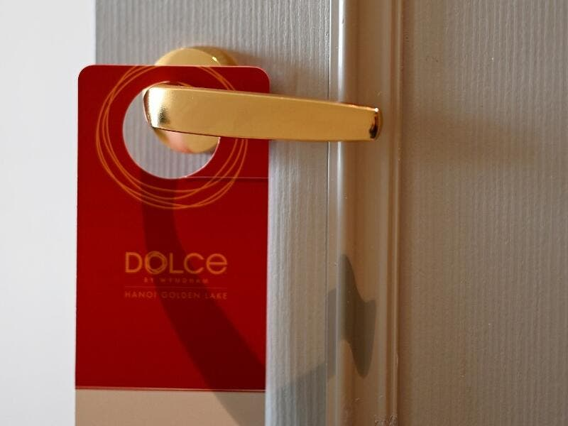 A placard hangs on a room's doorknob at the newly-inaugurated Dolce Hanoi Golden Lake hotel, the world's first gold-plated hotel, in Hanoi on July 2, 2020. Manan VATSYAYANA / AFP