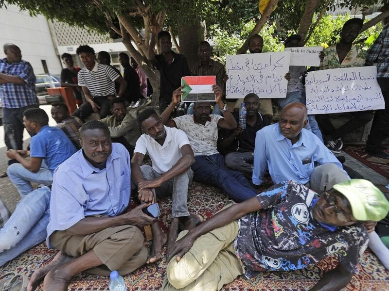 Sudanese workers, who lost their jobs due to the deteriorating economic situation in Lebanon, protest outside their county's embassy in Beirut to demand repatriation, on July 2, 2020. JOSEPH EID / AFP