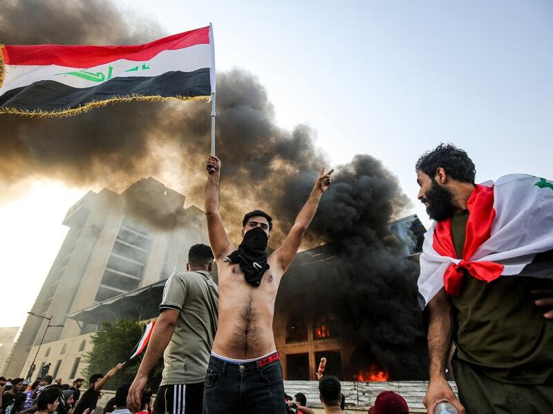 Since 1 October, thousands of people have descended on Baghdad's Tahrir Square protesting the lack of jobs, poor working conditions and widespread corruption. (Ahmad Al-Rubaye/ AFP)
