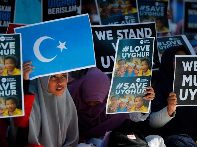 Indonesian Muslims demonstrate to denounce the Chinese goverment's policy on Uyghur Muslims. (AFP)